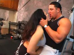 Muscular playgirl and her man fuck in gym