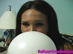 Kitty Bella loves to blow a balloon untill it pops