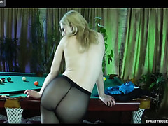 Naughty golden-haired cutie flashing her tight pantyhosed bottom in the billiard room
