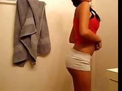 Dark brown teen with great love muffins filming herself stripping