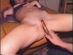 Charming wife receives her shaved slit filled with golden sex-toy, which her husband pokes into her leaking twat.
