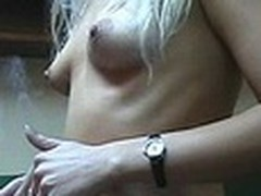 Lecherous golden-haired sweetheart with diminutive sticking tits walks naked in her room filmed by her boy-friend with dilettante cam in his hands. This guy doesn't like her smoking but really enjoys her hawt bare body shyly overspread by Fresh Year tree decoration :)