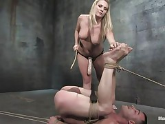 The dominating blonde milf wishes the man's dong but this babe wishes to fuck his booty even more! After tieing him with his legs up this babe sucks his dong and plays with his tight shaved anus before inserting a massive strap on sex tool in it. He groans as the sex tool goes unfathomable in his rectum and has to obey in front of the breasty blonde