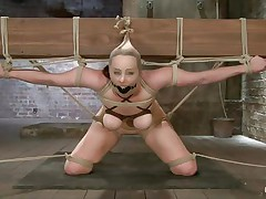 This babe really under the pressure! Bella is tied on that large wooden beam, ball gagged and with her zeppelins squeezed. Her dominant-bitch plays with those zeppelins and then goes behind her to play with her gazoo too. That booty is round and sexy and a large sex-toy inside it makes it look even better. How lengthy will it be until she squirts?