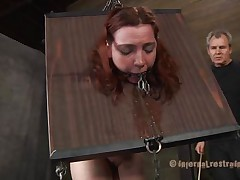 She's horrified of what's about to happen and who can blame the bitch? Take a look at her, how that playgirl is secured in that bondage device and has a device in her face hole that keeps it opened. The executor doesn't wastes time and spanks her white gazoo before fucking her face hole and bald muff with a big dildo.