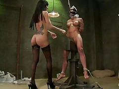 Gia DiMarco is a bad pussy, she enjoys punishing other strumpets by whipping and suffocating them. Look at her all naked wearing no thing but a pair of high heels and black hose as she punish and dominates this milf, grabbing her by the nipps and pulling the rope around her neck. Her big boobs sexy legs and gorgeous gazoo is sufficiently to make any guy want to be tied and punished by her.