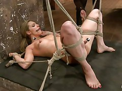 Take a look how hard her snatch is sucked! The golden-haired babe is about to get a hard castigation from her experienced mistress. She hangs her upside down, removes the sucker and oils her pussy. After that the mistress fingers deeply the blonde's fur pie and makes her shriek insanely and almost to cum!