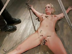 Slutty blonde Marie has her body all tied up and her legs widen on the floor. Her horny executor enjoys touching her wet shaved pussy and torturing it at the same time with a lot of laundry pliers. This guy tickles it, but doesn`t let her cum also soon. This guy 1st wants to bring a sex tool in the scene. So hot!