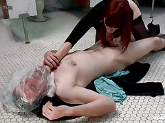 This stud receives attention from his devilish redhead and can't live without it. the divine floozy used a plastic bag to suffocate her large boy and even grabbed him by the neck while sucking his cock. Now he's allowed to finger her cunt for a short period of time in advance of getting ass slapped with a paddle. What else the mistress prepared?