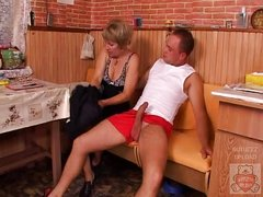 Mature mother and the Son&,#039,s ally have a nice time on kitchen.