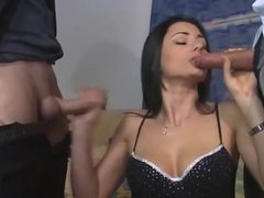 Euro girl in boots feasts on two dicks