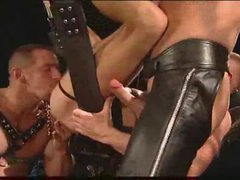 Gay leather chaps having intense sex